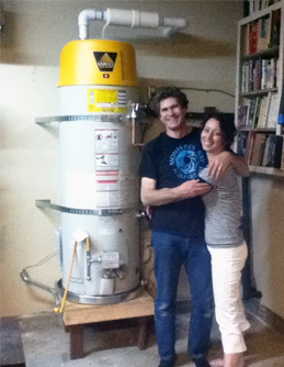 Happy couple with their brand new water heater from Water Heaters Only! Riverside