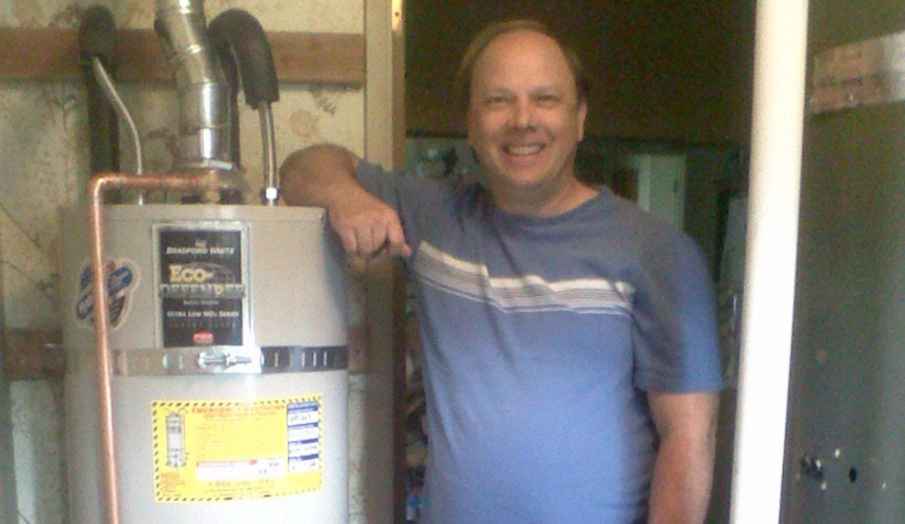 Another smiling customer with his brand new water heater! Riverside